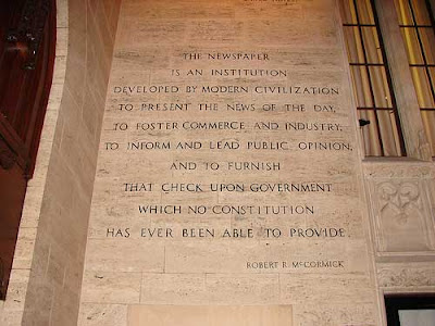 Quote engraved in stone wall