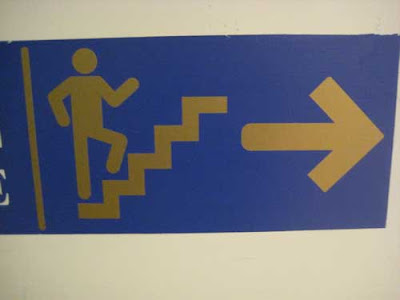 Walking figure on stairs with arms akimbo as if dancing