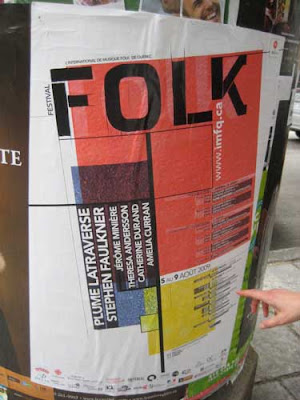 Large poster with the word FOLK at the top and Mondrian-style red, yellow and blue blocks with black lines below