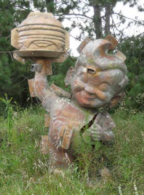 A mold for the Big Boy restaurant figure, surrounded by grass