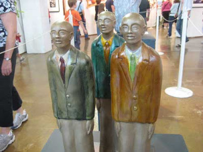 Three stylized African-American men in suit coats and ties, looking upward