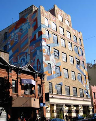 8 story building painted with a colorful car mural