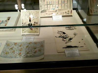 Display case with original artwork from Caps for Sale and Ferdinand