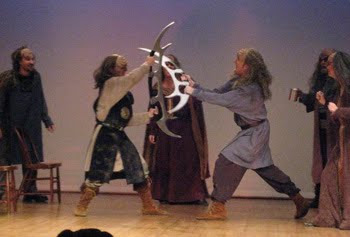 Theatrical Klingons battling on stage