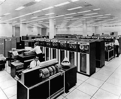 Black and white photo of a room-filling mainframe computer