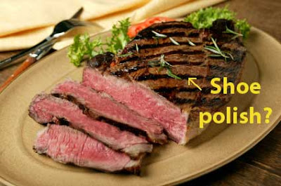 Very rare london broil-like piece of meat with brown grilling strips, labeled with yellow lettering Show Polish?
