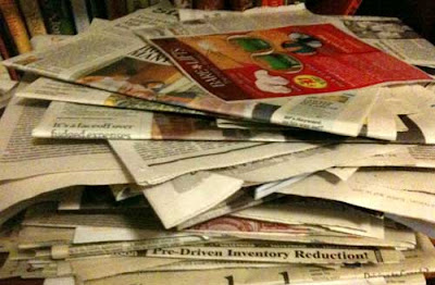 Large pile of newspapers