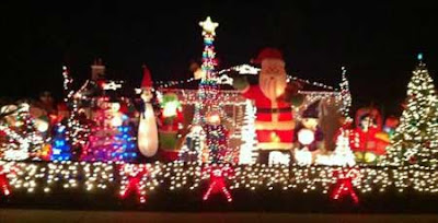 Giant inflated Santa and Christmas lights on a house
