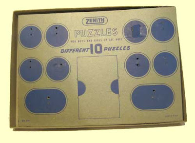 Gray cardboard with blue ink circles with holes showing where the puzzles were attached