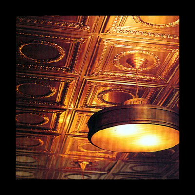 wallpapering ceiling.  a wallpaper ceiling- a metal or raised relif celing would be fantastic.