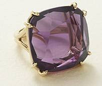 Dark amethyst and yellow gold ring