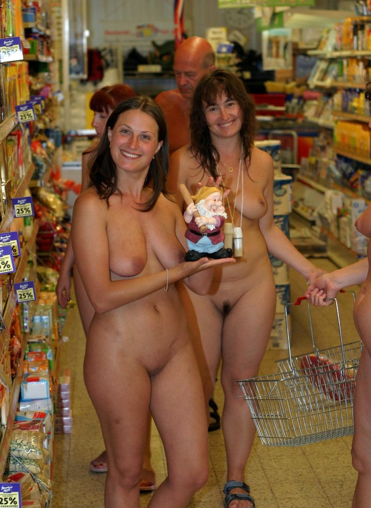 Nude girls in a shop attentively