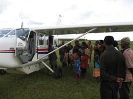 loading patients into the Airvan at Balimo
