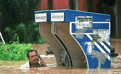 flooded telephone box, important call
