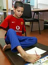 Ali Abbas practising foot painting (8/6/2003) I.C. adapted