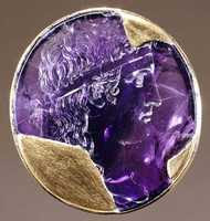 Attributed to Solon - Head of Apollo carved in Amethyst with a gold mount (Early 1st Century A.D.)