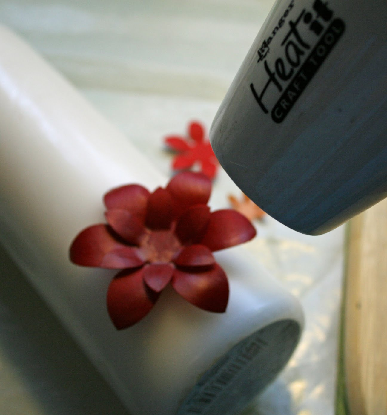 The paper trail on the eleventh day of christmas to attach the dipped flowers and leaves to the candle use your heat tool to carefully melt the wax of the candle slightly and the wax of the flower mightylinksfo
