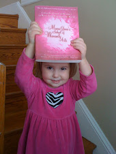 Gigi holding Mama Gena's book