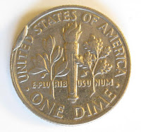 Dime with a cud, cud coin reverse