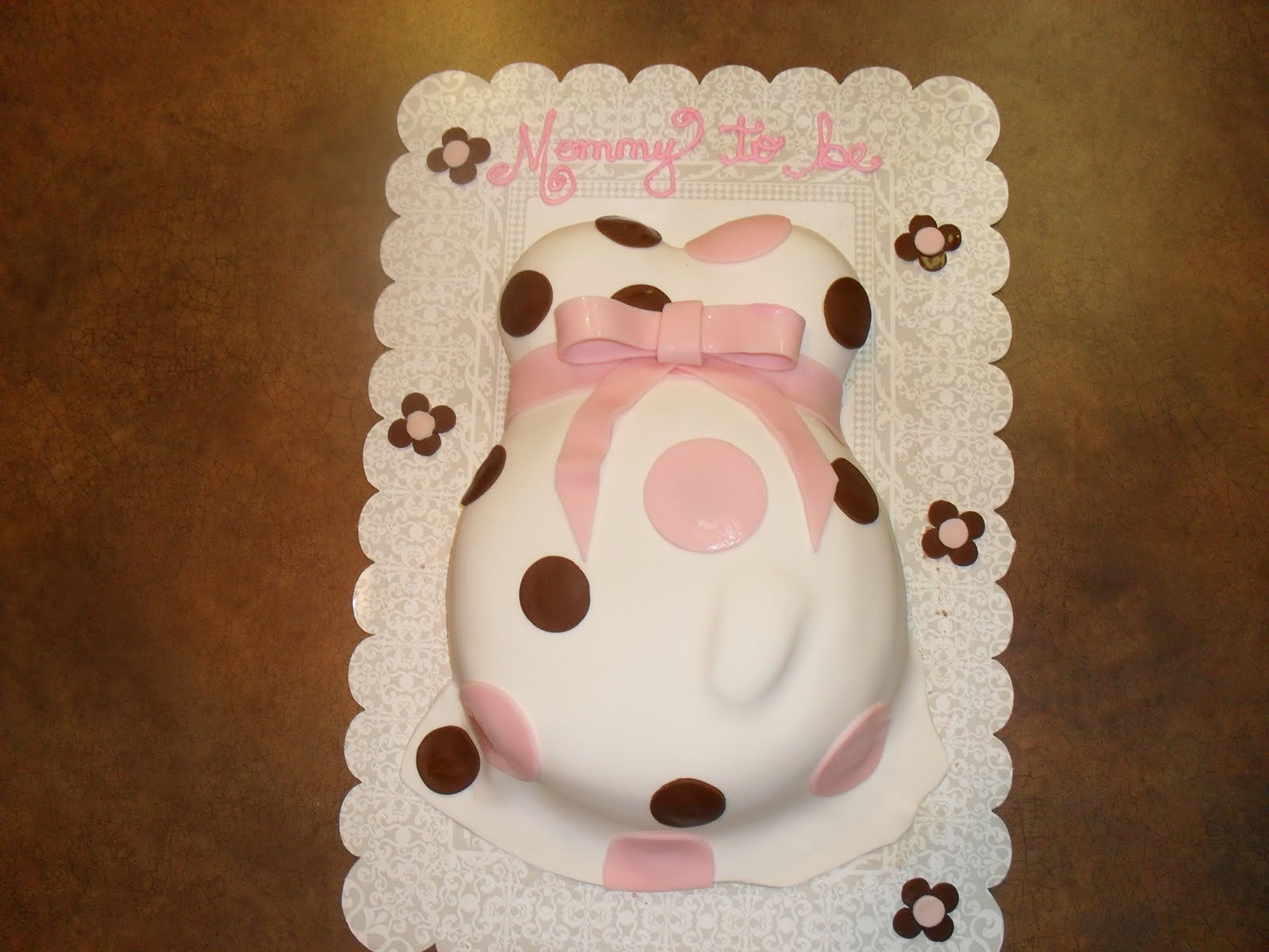 pregnant cake with baby foot
