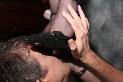 My slave worships at my feet