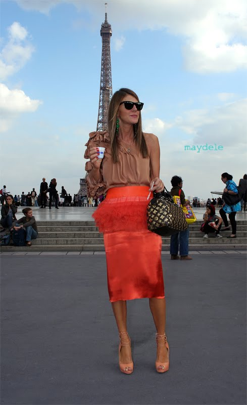 Anna dello Russo wearing a Chloé top, a Rochas fall winter 2003/2004 skirt, a Louis Vuitton Speedy Monogram Eclipse handbag and Christian Louboutin Juste shoes