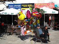 Balloon seller in Fountain Square, Heraklion