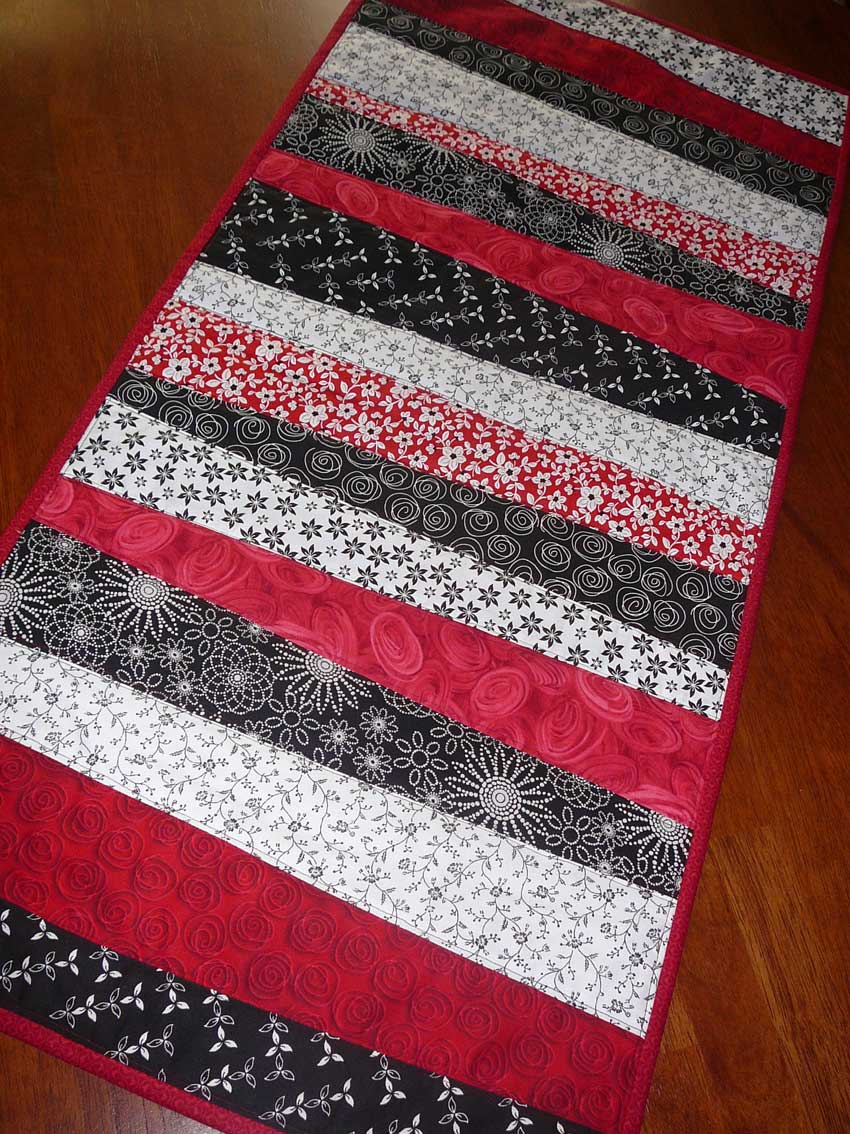 Patchy work of mini grey christmas table runner and