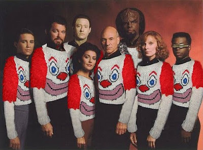 The entire cast of star trek TNG wearing horrible clown sweater
