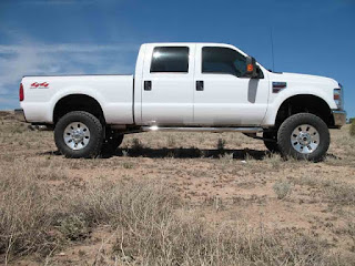 Ford F-250 4x4 Diesel equipped with Trail Master's 6-inch suspension lift kit and 35-inch diameter tires.
