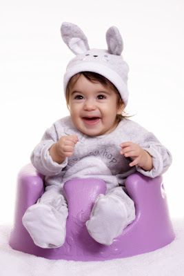 Happy baby sit on the cute chair