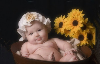 Beautiful baby with flower basket