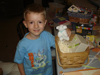 Our son, Jacob, helping put baskets together