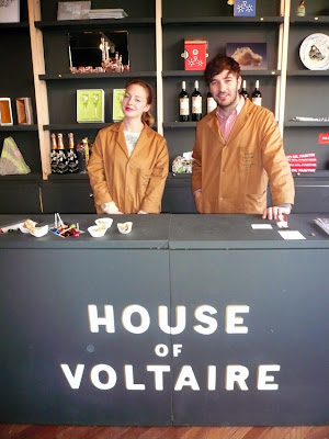 Art and design celebrities don the House of Voltaire work coat for their shift as shopkeeper for the day. Image courtesy Studio Voltaire.