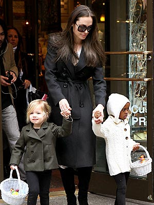 Angelina Jolie black trench coat with kids