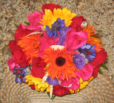 wedding bouquet of brightly colored hot pink roses and gerberas