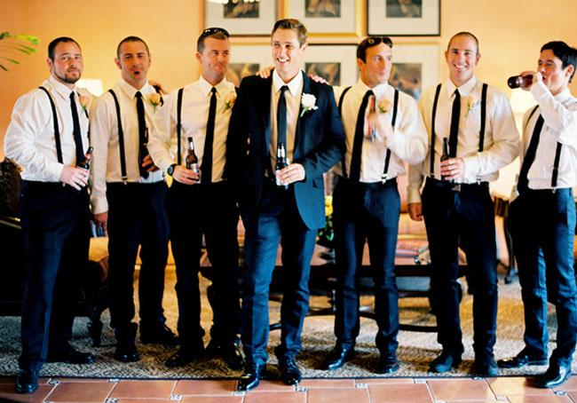 Groomsmen wearing suspenders.