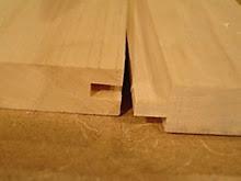 การทดสอบความแข็งแรงของรอยต่อการเพลาะไม้ยางพาราแบบรางลิ้นและบังใบในระยะที่แตกต่างกัน