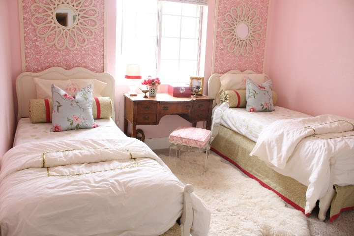 I just love pink. The wallpaper behind each bed.