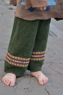 Image of green upcycled longies made from a wool sweater and vintage trim
