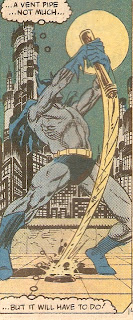 Batman pulls Excalibur from the stone...