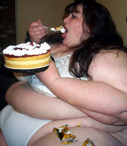 fat woman eating pie