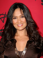 Tia Carrere in a Tight Snakeskin Skirt