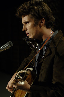 Christian Bale as folk singer Jack Rollins (who is really Bob Dylan)