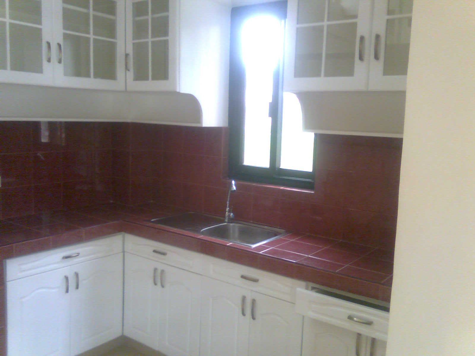 Pinoy pabahay dot com be the homeowner of this newly for Built in kitchen cabinets philippines