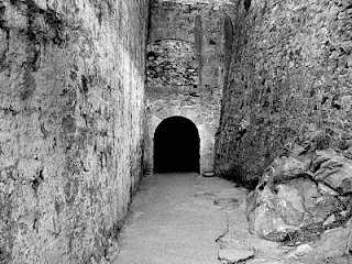 entrance into darkness; stonework and dark passage