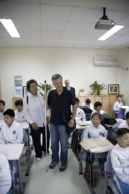Rami Rabby with cane in classroom of blind students