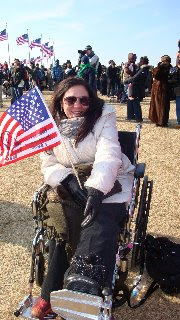 Steph in wheelchair and coat