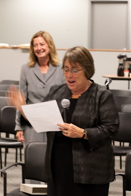 Undersecretary of Education Martha Kanter administering the swearing in oath, with Assistant Secretary Alexa Posny smiling in the background