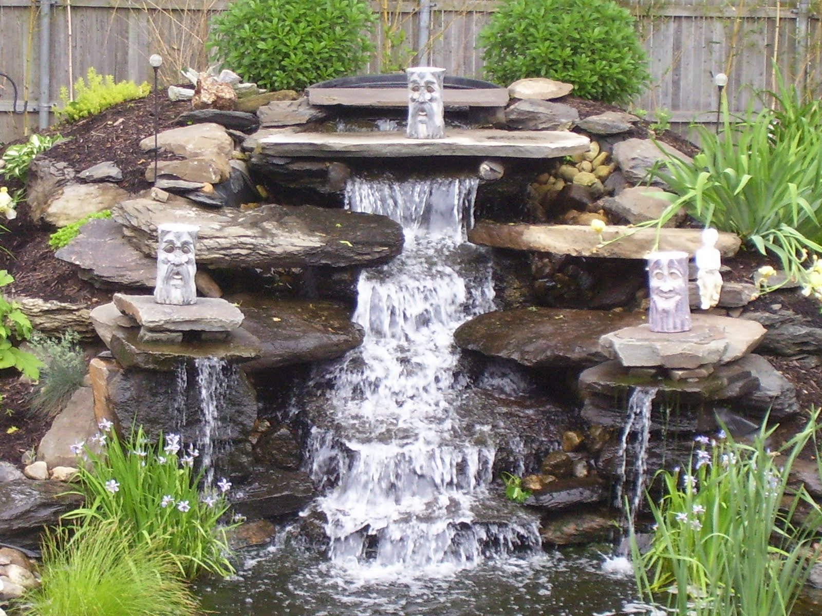 Waterfall Landscape Design Ideas this pond sits in the center of an enormous garden and features a two tiered Download This Waterfall Upstate Picture